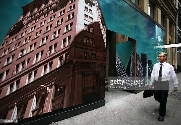 A pedestrian walks past an advertisement promoting a new business development in Sydney Australia on Wednesday March 4 2009 Australia's economy...