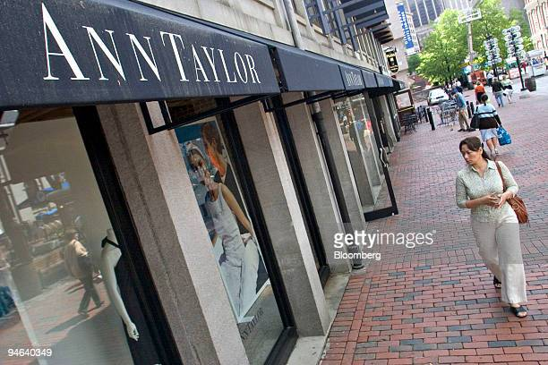 A pedestrian walks past an Ann Taylor store in Boston Massachusetts Friday May 19 2006 AnnTaylor Stores Corp the women's clothing retailer said...
