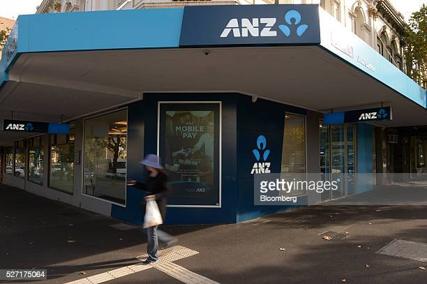 A pedestrian walks past an Australia New Zealand Banking Group Ltd branch in Melbourne Australia on Monday May 2 2016 ANZ is scheduled to report...