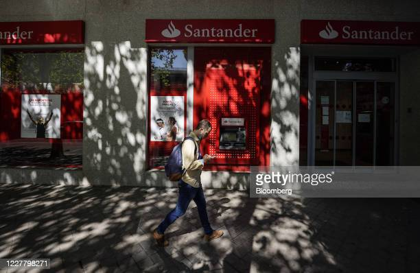 Pedestrian walks past an automated teller machine outside a Banco Santander SA bank branch in Madrid, Spain, on Saturday, July 25, 2020. Banks in...
