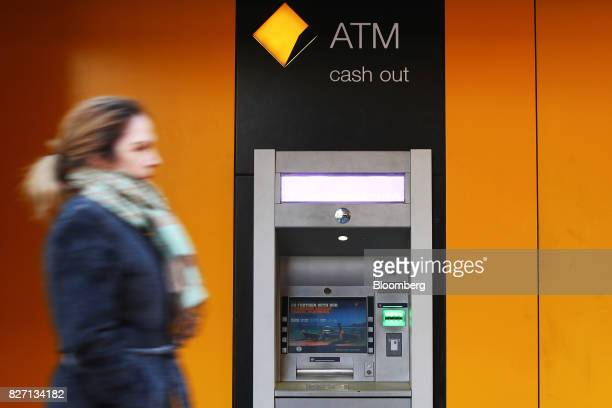A pedestrian walks past an automated teller machine outside a Commonwealth Bank of Australia branch in Sydney Australia on Monday Aug 7 2017...