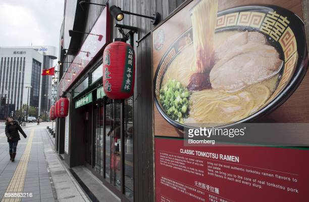 A pedestrian walks past an Ichiran Inc tonkotsu ramen restaurant in Fukuoka Japan on Dec 22 2017 Fukuoka on Japans southern island of Kyushu is...