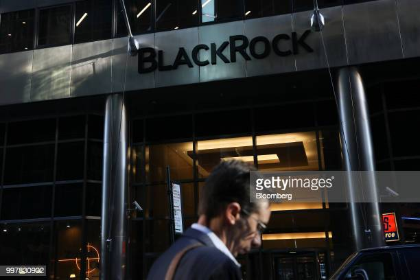 A pedestrian walks past BlackRock Inc headquarters in New York US on Wednesday June 11 2018 BlackRock Inc is scheduled to release earnings figures on...