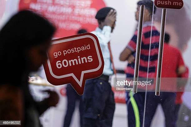 A pedestrian walks past by a Bharti Airtel Ltd store in Mumbai India on Monday Oct 19 2015 Bharti Indias largest wireless carrier is scheduled to...