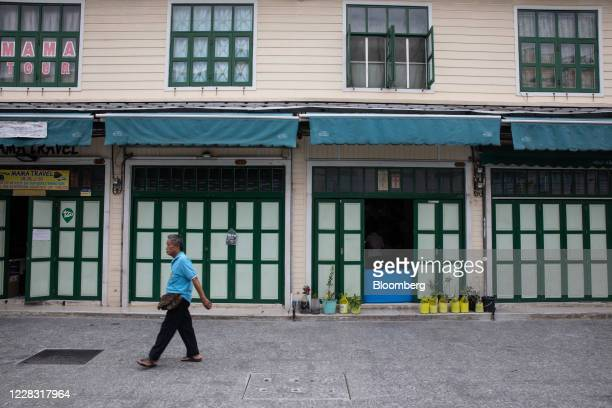 A pedestrian walks past closed stores at a deserted Khao San Road in Bangkok Thailand on Wednesday Sept 2 2020 Thailand has reported zero...