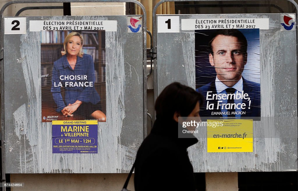 New Posters of France Presidential Candidates Emmanuel Macron And Marine Le Pen Are Displayed In Paris : News Photo
