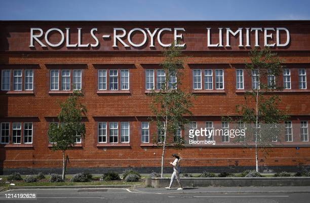 Pedestrian walks past former Rolls-Royce Holdings Plc facility that was the birthplace of the Silver Ghost and Merlin aero engine, in Derby, U.K., on...