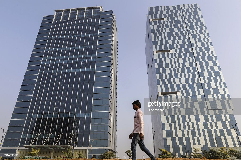 General views of the under construction tec city a pedestrian walks past gift tower one left and gift tower two in gujarat negle Images
