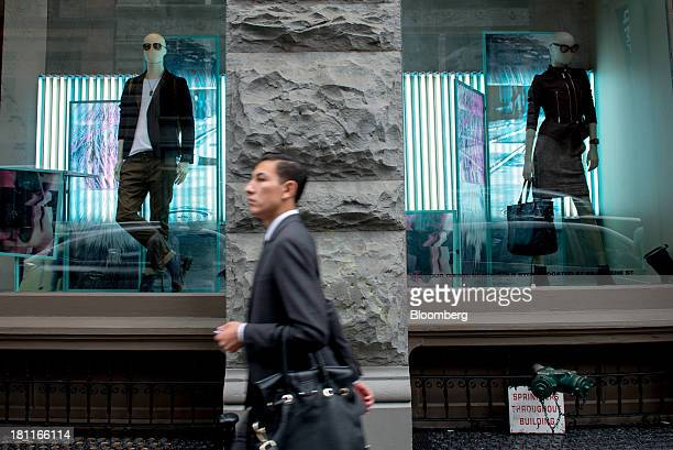 A pedestrian walks past mannequins in the window of a Diesel store in the shopping district of Soho in New York US on Saturday Sept 14 2013 Consumers...