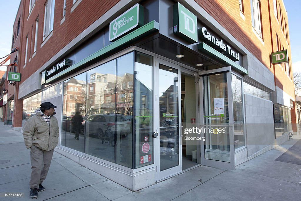 A pedestrian walks past one of Toronto-Dominion Bank's (TD) Canada Trust branches in Toronto, Ontario, Canada, on Tuesday, Dec. 21, 2010. Toronto-Dominion Bank agreed to buy Chrysler Financial Corp. from Cerberus Capital Management LP for $6.3 billion in cash, adding an auto-finance company in its second-largest acquisition. Photographer: Norm Betts/Bloomberg via Getty Images
