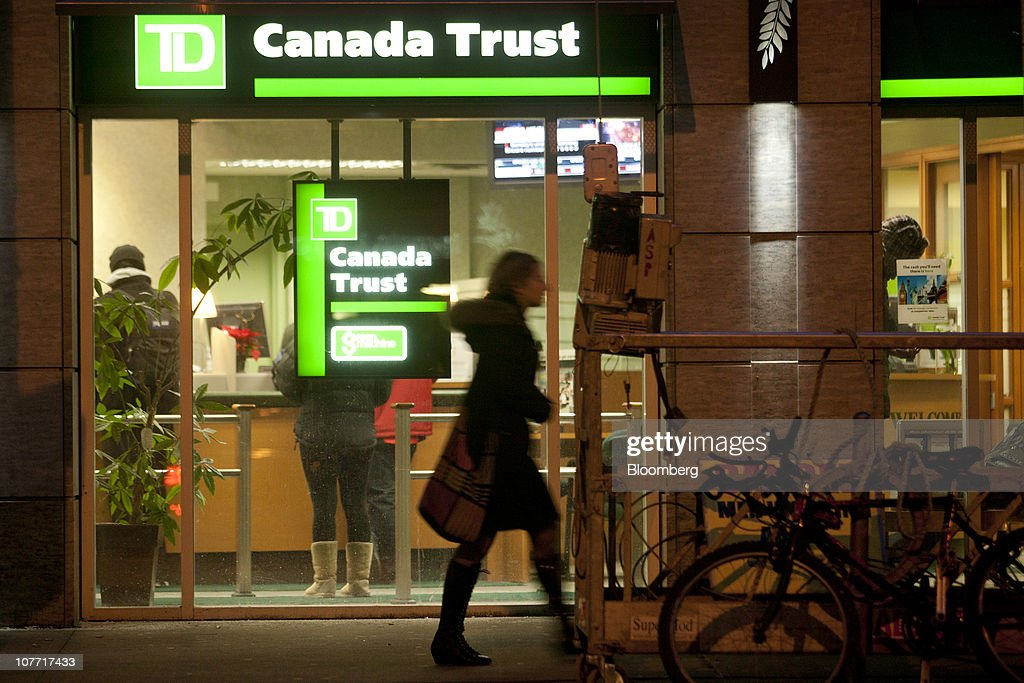 A pedestrian walks past one of Toronto-Dominion Bank's (TD) Canada Trust branches in Toronto, Ontario, Canada, on Monday, Dec. 20, 2010. Toronto-Dominion Bank agreed to buy Chrysler Financial Corp. from Cerberus Capital Management LP for $6.3 billion in cash, adding an auto-finance company in its second-largest acquisition. Photographer: Norm Betts/Bloomberg via Getty Images