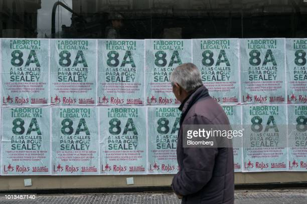 A pedestrian walks past prochoice signs during a protest outside of the National Congress building in Buenos Aires Argentina on Wednesday Aug 8 2018...