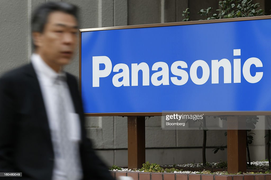 A pedestrian walks past signage for Panasonic Corp. outside the company's branch in Tokyo, Japan, on Friday, Feb. 1, 2013. Panasonic, Japan's second-biggest television maker, reported an unexpected third-quarter profit because of a weaker yen and restructuring efforts. Photographer: Kiyoshi Ota/Bloomberg via Getty Images