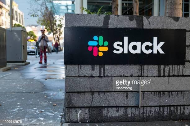 Pedestrian walks past Slack Technologies Inc. Headquarters in San Francisco, California, U.S., on Wednesday, Dec. 2, 2020. Salesforce.com Inc. Agreed...