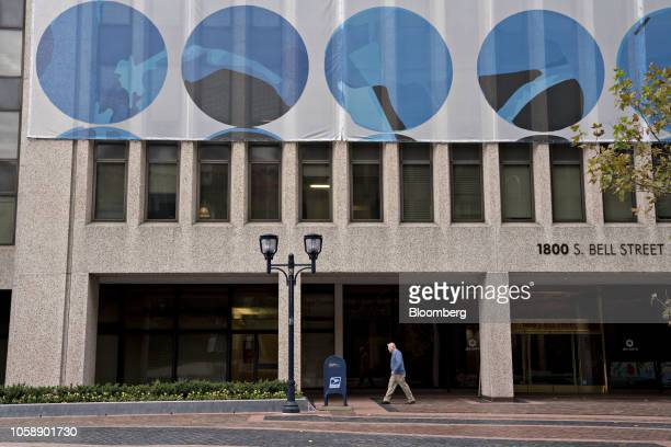 A pedestrian walks past the 1800 S Bell Street building in the Crystal City area of Arlington Virginia US on Wednesday Nov 7 2018 Seattlebased Amazon...