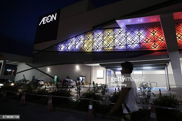 A pedestrian walks past the Aeon Co mall at night in the Long Bien district of Hanoi Vietnam on Thursday July 21 2016 With a young population an...