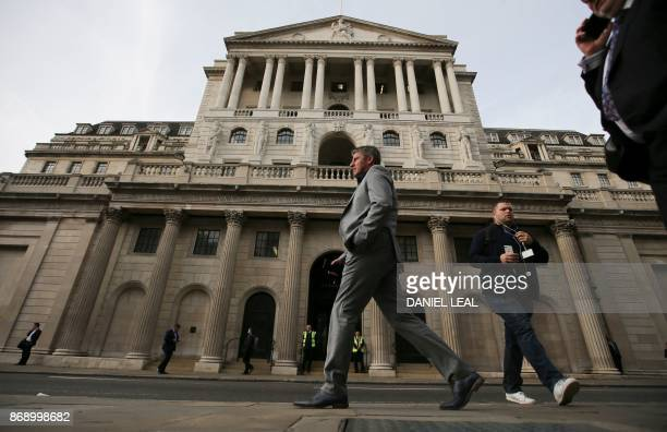 A pedestrian walks past The Bank of England in the City of London on November 1 2017 The Bank of England on guard against soaring Brexitfuelled...