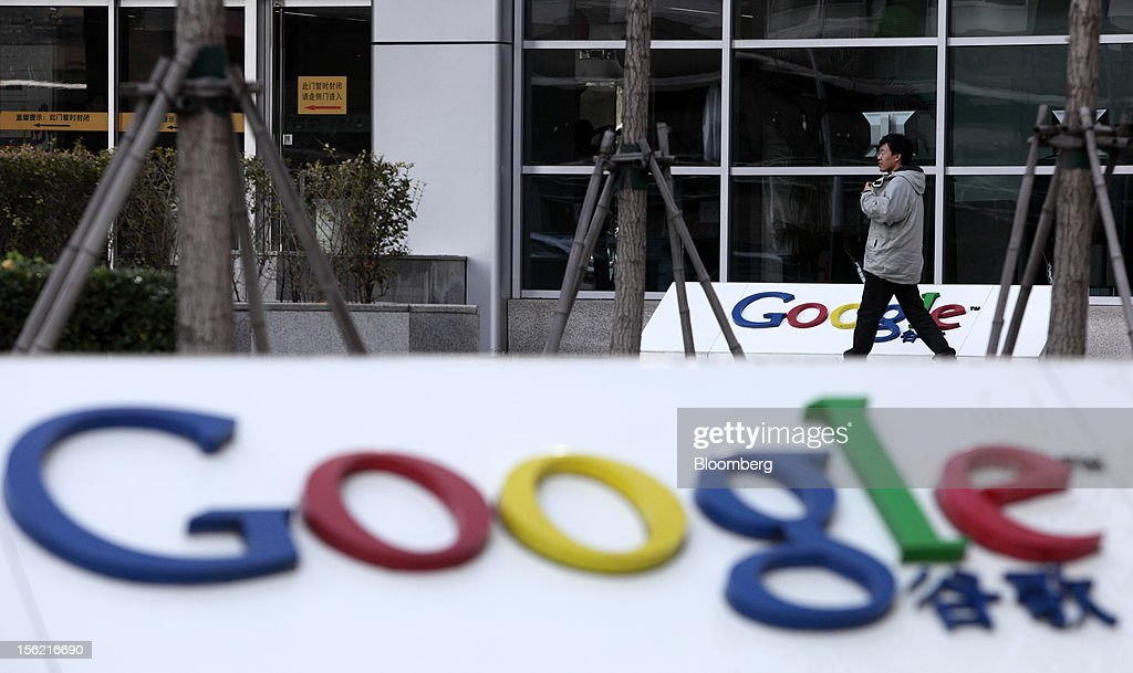 A pedestrian walks past the building housing the Google Inc. China headquarters in Beijing, China, on Monday, Nov. 12, 2012. Google Inc. reported higher traffic patterns on its sites in China after the company earlier said there was an unusual decline in the country, and an Internet monitor said company services were blocked there. Photographer: Tomohiro Ohsumi/Bloomberg via Getty Images