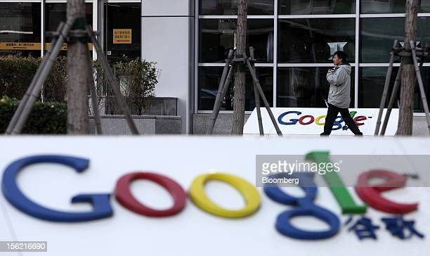 A pedestrian walks past the building housing the Google Inc China headquarters in Beijing China on Monday Nov 12 2012 Google Inc reported higher...