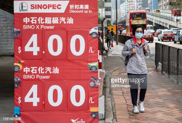 Pedestrian walks past the Chinese oil and gas enterprise China Petroleum & Chemical Corporation, known as Sinopec, gas station seen in Hong Kong.