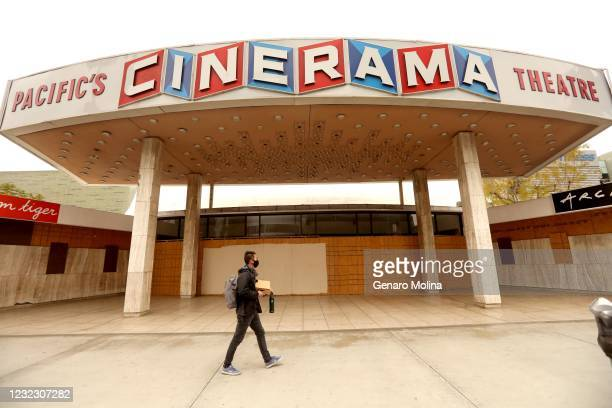 Pedestrian walks past the Cinerama Dome in Hollywood on April 13, 2021. ArcLight Cinemas and Pacific Theaters said late Monday they are ceasing...