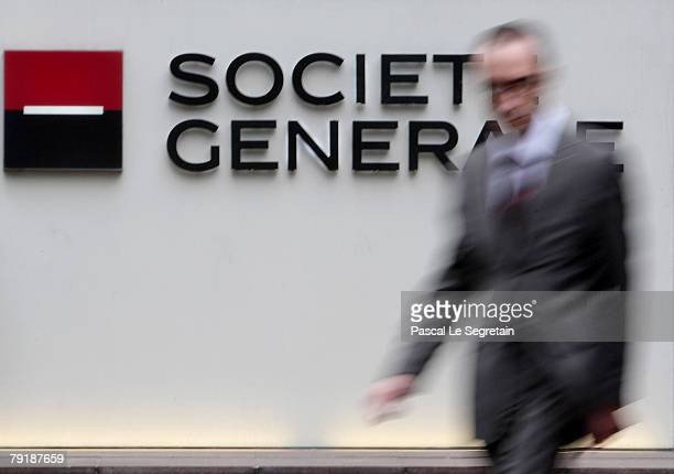 Pedestrian walks past the corporate logo of the Societe Generale Bank outside the bank's headquarters on January 24 2008 in La Defense Fraud by a...