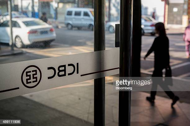 A pedestrian walks past the entrance of a Industrial and Commercial Bank of China Ltd branch in the Gongbei district of Zhuhai Guangdong province...