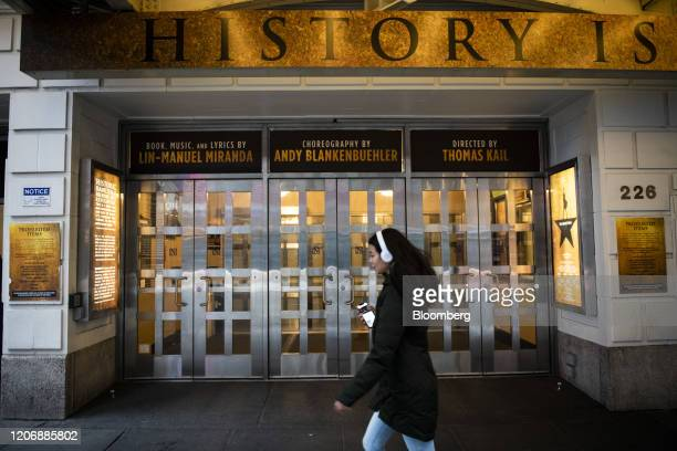 A pedestrian walks past the entrance to Richard Rodgers Theatre where the musical Hamilton is performed in the Times Square neighborhood of New York...