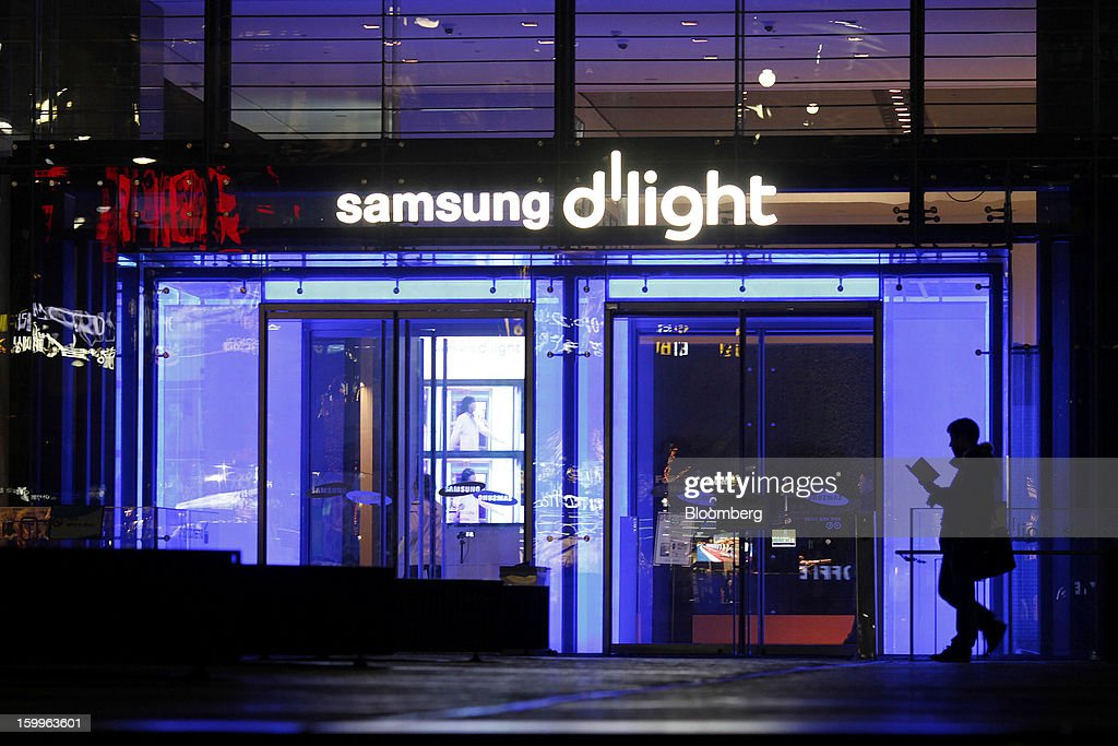 A pedestrian walks past the entrance to Samsung Electronics Co.'s Samsung d'light showroom and store in Seoul, South Korea, on Wednesday, Jan. 23, 2013. Samsung, in a preliminary statement of results on Jan. 8, reported an 89 percent jump in profit in the three months ended in December, boosted by its Galaxy line of smartphones. Photographer: Woohae Cho/Bloomberg via Getty Images