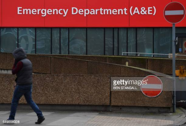 A pedestrian walks past the entrance to the Accident Emergency department of St Thomas' Hospital in central London on March 8 2017 Britain's economy...