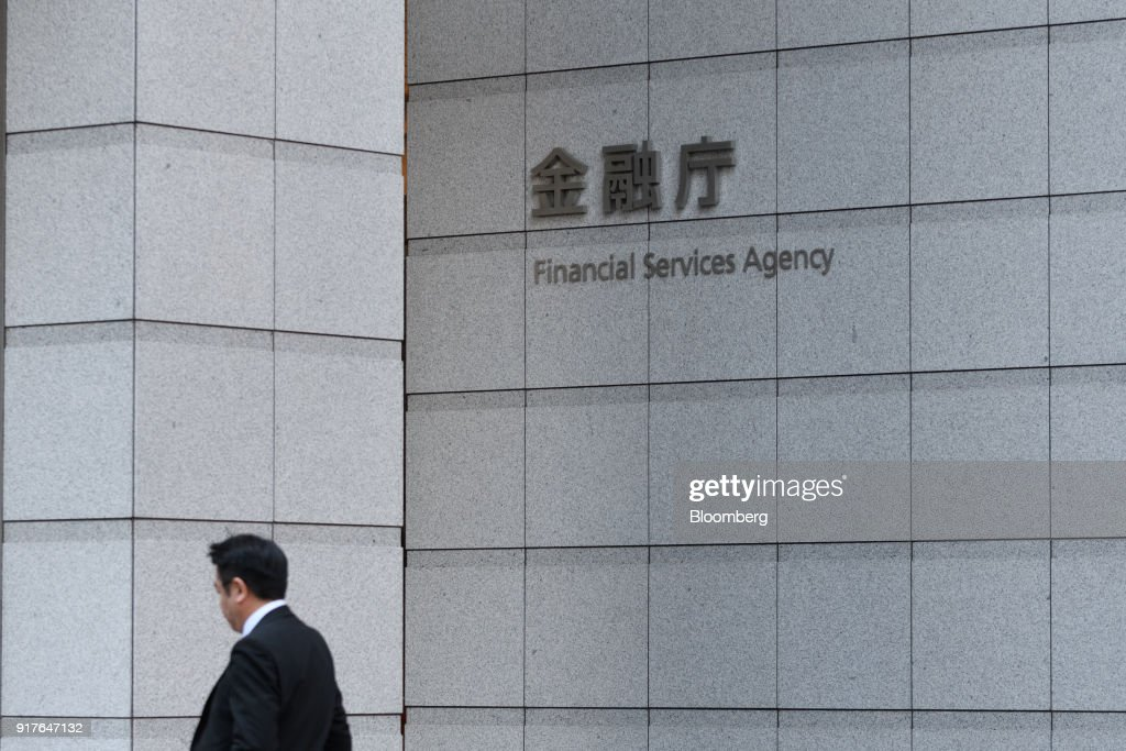 A pedestrian walks past the Financial Services Agency (FSA) headquarters in Tokyo, Japan, on Tuesday, Feb. 13, 2018. Cryptocurrency exchange Coincheck Inc., which lost about$500 millionto hackers last month, faced a deadline Tuesday to explain how the hack occurred and plans for improving its security to regulators at Japan's FSA.Photographer: Akio Kon/Bloomberg via Getty Images