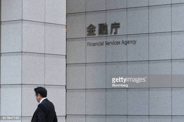 A pedestrian walks past the Financial Services Agency headquarters in Tokyo Japan on Tuesday Feb 13 2018 Cryptocurrency exchange Coincheck Inc which...