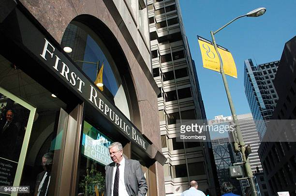 Pedestrian walks past the First Republic Bank headquarters in downtown San Francisco, CA., on Monday, Jan. 29, 2007. Merrill Lynch & Co., in its...