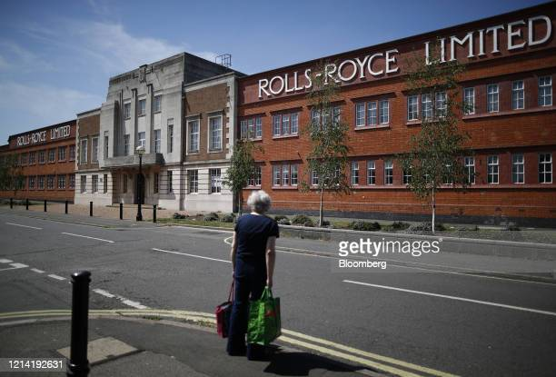 Pedestrian walks past the former Rolls-Royce Holdings Plc facility that was the birthplace of the Silver Ghost and Merlin aero engine, in Derby,...