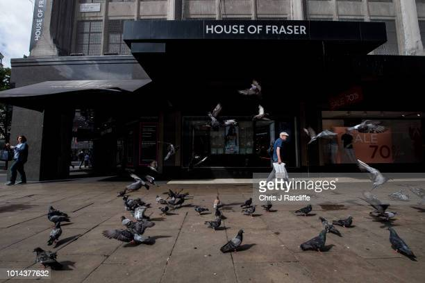 A pedestrian walks past the House of Fraser flagship store on Oxford Street on August 10 2018 in London England The high street retailers House of...