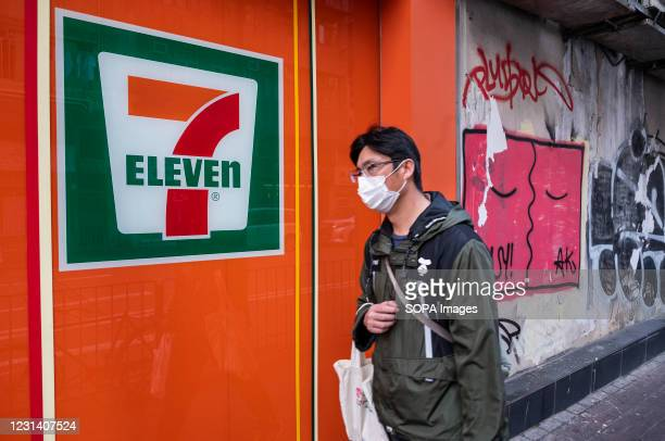 Pedestrian walks past the Japanese-owned American international chain of convenience store, 7-Eleven is seen in Hong Kong.