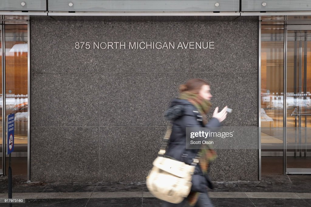 A pedestrian walks past the John Hancock Center, one of Chicago's most famous skyscrapers, on February 13, 2018 in Chicago, Illinois. John Hancock Financial, the building's former owners and namesake, has asked that its name and logos be removed from the building immediately. The building will be known by its address 875 North Michigan Avenue until a new naming rights deal can be arranged.