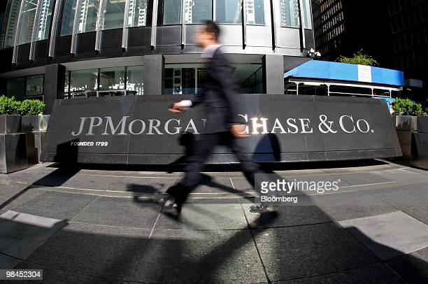 A pedestrian walks past the JPMorgan Chase Co headquarters in New York US on Wednesday April 14 2010 JPMorgan Chase Co the second biggest US bank by...