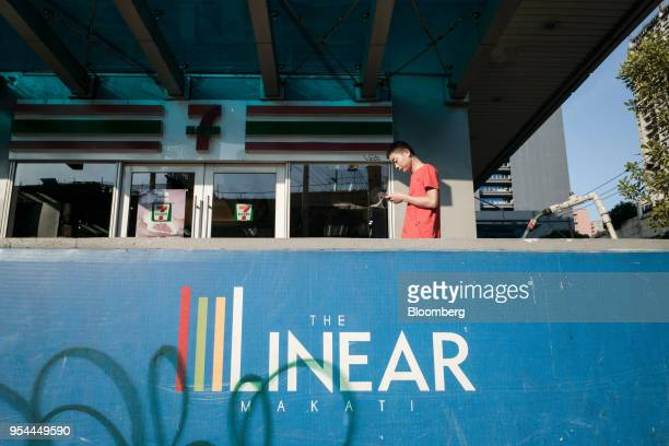 A pedestrian walks past the Linear Makati development in the San Antonio Village area of Makati City Manila the Philippines on Wednesday May 2 2018...