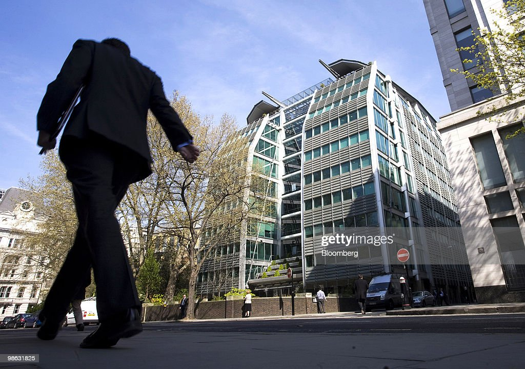 A pedestrian walks past the Lloyds Banking Group Plc.company headquarters, center, in Gresham Street, London, U.K., on Friday, April 23, 2010. Goldman Sachs Group Inc. had two roles in Lloyds Banking Group Plc's refinancing last year, as both an investor and an underwriter, the Financial Times reported, citing four people involved in the capital raising. Photographer: Chris Ratcliffe/Bloomberg via Getty Images