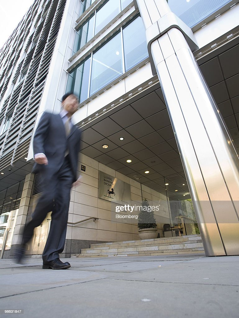A pedestrian walks past the Lloyds Banking Group Plc.company headquarters in Gresham Street, London, U.K., on Friday, April 23, 2010. Goldman Sachs Group Inc. had two roles in Lloyds Banking Group Plc's refinancing last year, as both an investor and an underwriter, the Financial Times reported, citing four people involved in the capital raising. Photographer: Chris Ratcliffe/Bloomberg via Getty Images