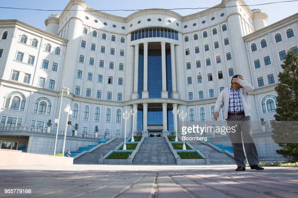 A pedestrian walks past the National Library of Tajikstan in Dushanbe Tajikistan on Saturday April 21 2018 Flung into independence after the Soviet...