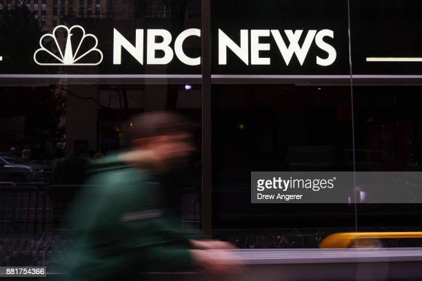 A pedestrian walks past the NBC News studios November 29 2017 in New York City It was announced on Wednesday morning that long time Today Show host...