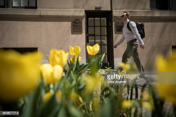 A pedestrian walks past the office of Dr Harold Bornstein who was previously President Donald Trump's longtime personal physician May 2 2018 in New...