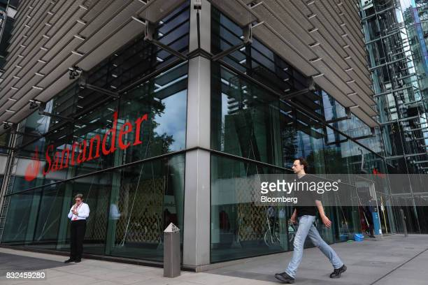 A pedestrian walks past the offices of Banco Santander SA in London UK on Tuesday Aug 15 2017 Banco Santander Spains biggest lender has bought...