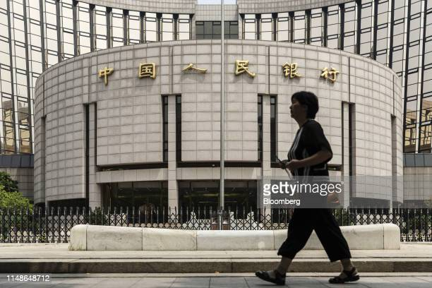 Pedestrian walks past the People's Bank of China headquarters in Beijing, China, on Friday, June 7, 2019. China's central bank governor said there's...