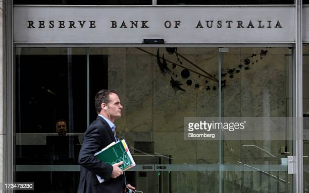 A pedestrian walks past the Reserve Bank of Australia headquarters in the central business district of Sydney Australia on Monday July 15 2013 While...