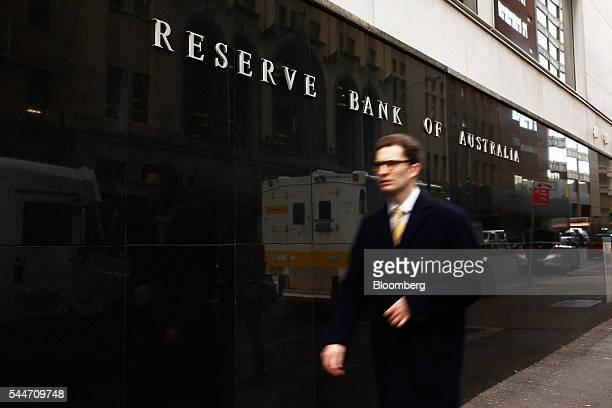 A pedestrian walks past the Reserve Bank of Australia headquarters in Sydney Australia on Monday July 4 2016 Australia's failure to make a decisive...