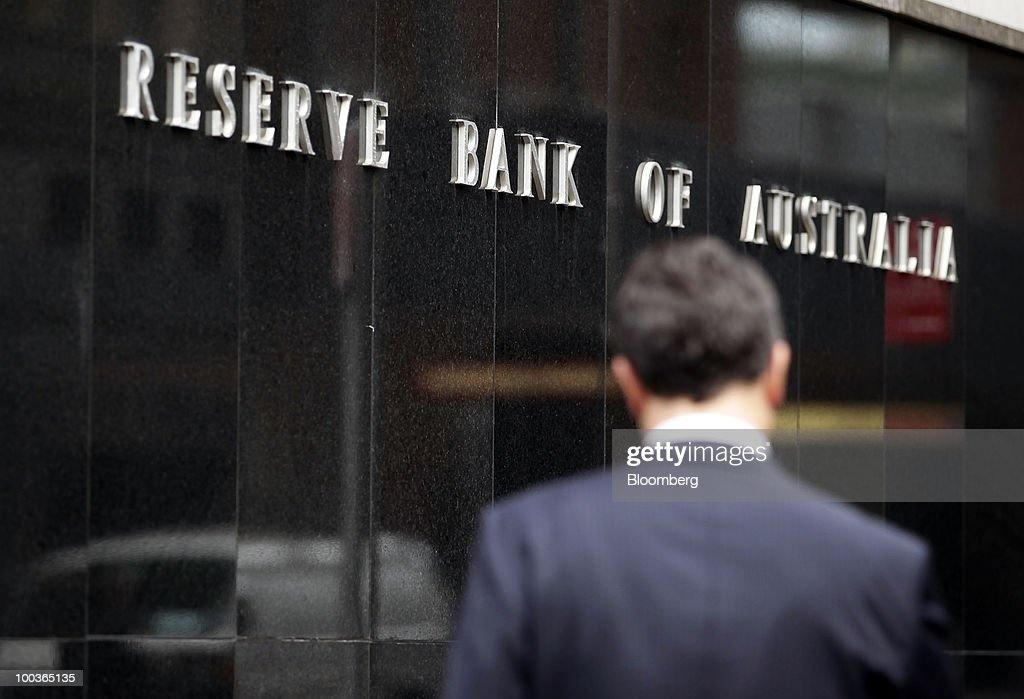 A pedestrian walks past the Reserve Bank of Australia in Sydney, Australia, on Monday, May 24, 2010. The Australian and New Zealand dollars fell against the U.S. currency, extending a three-week decline, on concern Europe's debt crisis will spread. Photographer: Ian Waldie/Bloomberg via Getty Images