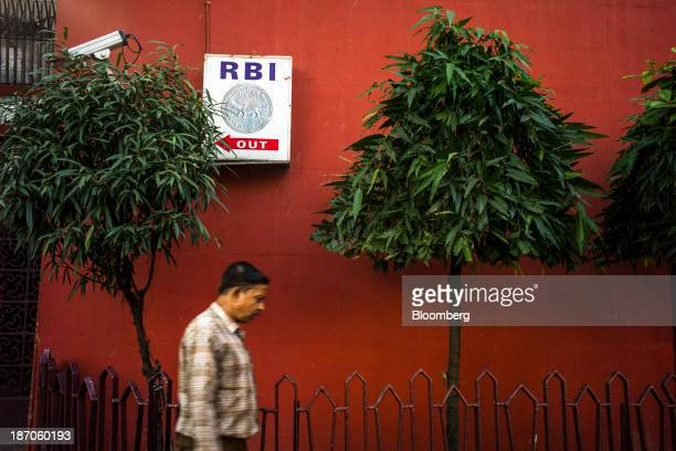 A pedestrian walks past the Reserve Bank of India building in the BBD Bagh area of Kolkata West Bengal India on Thursday Oct 31 2013 Indian stocks...